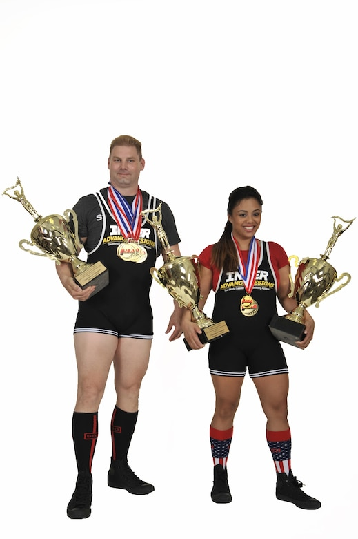 Master Sgt. David Martin and Staff Sgt. Kimberly Francois recently earned medals and trophies during the 24th annual USA Powerlifting Military Championships in Orlando, Florida. They are stationed at Scott Air Force Base, Ill. (U.S. Air Force illustration/Senior Airman Megan Friedl)