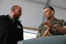Col. Eric Austin, right, explains the capabilities of the AV-8B Harrier to Havelock Mayor William Lewis during a tour of the flight line at Marine Corps Air Station Cherry Point, N.C., April 6, 2016. According to Lewis, the tour was part of his efforts to strengthen the already well-established relationship between the Havelock and Cherry Point communities. He looks to grow community ties with the air station by understanding the mission of the 2nd Marine Aircraft Wing and its squadrons, said Lewis. Austin is the commanding officer of Marine Aircraft Group 14. (U.S. Marine Corps photo by Lance Cpl. Mackenzie Gibson/Released.)