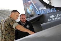 Col. Eric Austin, left, points at the wing of an AV-8B Harrier with Havelock Mayor William Lewis during a tour of the flight line at Marine Corps Air Station Cherry Point, N.C., April 6, 2016 According to Lewis, the tour was part of his efforts to strengthen the already well-established relationship between the Havelock and Cherry Point communities. He looks to grow community ties with the air station by understanding the mission of the 2nd Marine Aircraft Wing and its squadrons, said Lewis. Austin is the commanding officer of Marine Aircraft Group 14. (U.S. Marine Corps photo by Lance Cpl. Mackenzie Gibson/Released.)