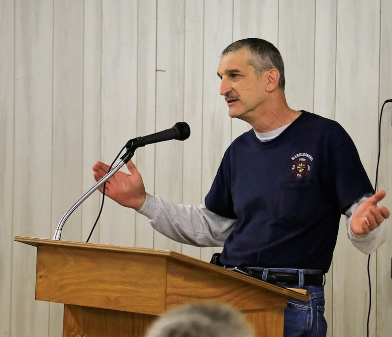Marklesburg Volunteer Fire Department President Brian Hunsicker accepts the 2015 Excellence in Partnership Award on behalf of the fire company during an awards ceremony in Marklesburg, Pennsylvania, April 6, 2016.