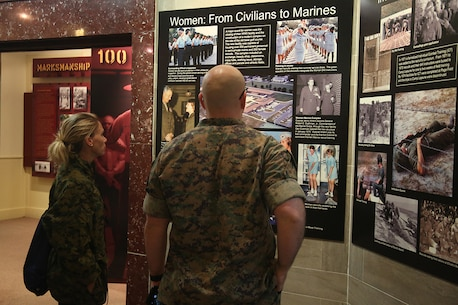 Staff Sgt. Robert Etzler, recruiter from Recruiting Substation Dothan, and Missy Bossardet, discuss with each other how women have impacted the Marine Corps in the Parris Island Museum aboard Marine Corps Recruit Depot Parris Island, S.C., April 14, 2016. The teachers, coaches, and principals of Recruiting Stations Jacksonville and Montgomery participate in a three-day workshop designed to inform educators about military service and life in the Marine Corps. (Official Marine Corps photo Cpl. John-Paul Imbody)