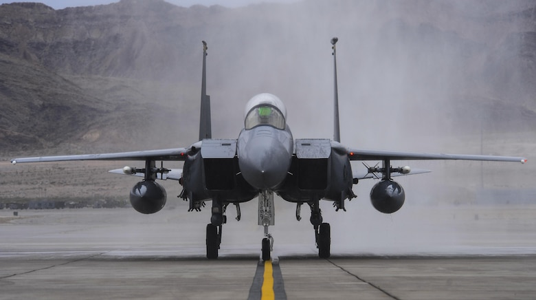 Brig. Gen. Christopher Short, 57th Wing commander, taxis down the runway in an F-16 Fighting Falcon after being sprayed by fire trucks during his fini flight at Nellis Air Force Base, Nev., April 8, 2016. A fini flight is a pilot's last flight in an aircraft before he/she leaves a squadron, a wing, or retires from the Air Force. (U.S. Air Force photo by Airman 1st Class Kevin Tanenbaum)