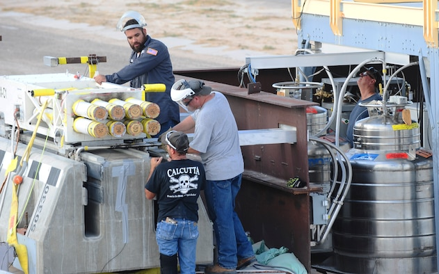 Technicians from the 846th Test Squadron at Holloman Air Force Base, N.M., prepare a rocket-propelled sled for a launch here Aug. 18, 2015. Teams of engineers, technicians and computer program experts all worked together to break the world record for speed on a magnetically-levitated sled system. The test, taking place March 4, 2016, sent the sled accelerating at 633 mph – shattering the previous record of 513 mph. (U.S. Air Force photo by Airman 1st Class Randahl J. Jenson)