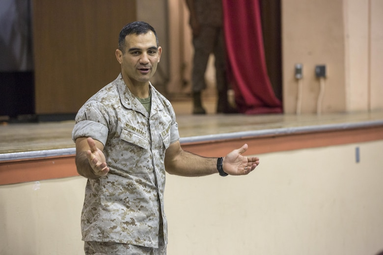 Lt. Col. Speros C. Koumparakis, battalion commander, Communication Training Battalion, Marine Corps Communication-Electronics School, speaks during change of command ceremony for Company D at the Combat Center theater April 1, 2016. (Official Marine Corps photo by Lance Cpl. Levi Schultz/Released)