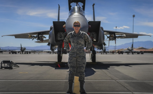 Capt. Madison Gilbert, 757th Aircraft Maintenance Squadron, officer in charge, stands in front of F-15E Strike Eagle on the Nellis Air Force Base, flight line, March 31. As the OIC, she is responsible for 16, F-15E Strike Eagle aircraft and 170 maintainers.