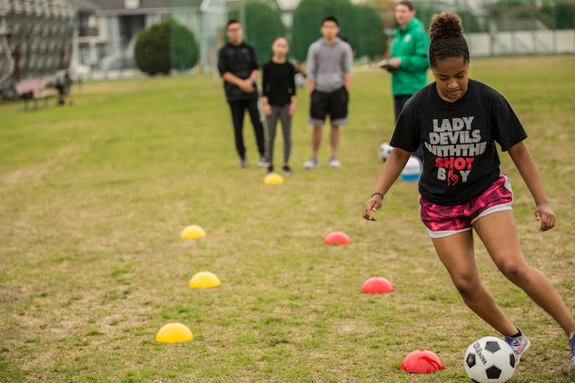 Maya Pugh, a teen from Yokosuka Naval Base, relays a soccer ball through cones during a fitness competition at the 2016 Asia Keystone Conference at Marine Corps Air Station Iwakuni, Japan, April 13, 2016. Teens from various Boys and Girls Clubs across Asia participated in events like this and more during the 2016 Asia Keystone Conference. (U.S. Marine Corps photo by Cpl. Nathan Wicks/Released)