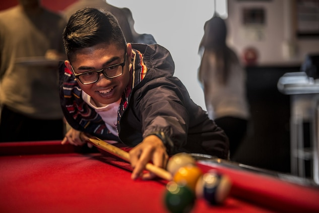 Ryan JayVisico, a teenager from Yokota Air Base, plays pool during the 2016 Asia Keystone Conference at Marine Corps Air Station Iwakuni, Japan, April 13, 2016. The Keystone Club and Boys and Girls Club of Iwakuni hosted this event to bring teens from different parts of the world together and name 2016's Asia State Military Youth of the Year. (U.S. Marine Corps photo by Cpl. Nathan Wicks/Released)