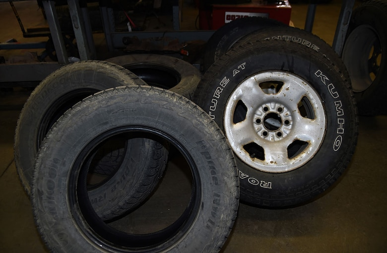 A set of winter tires are dismounted while a set of summer tires are mounted on rims at the Auto Skills Center, Joint Base Elmendorf-Richardson, Alaska, April 14, 2016. According to the Division of Motor Vehicles, it is unlawful to operate a motor vehicle with studded tires on a paved highway or road from May 1 through September 15. (U.S. Air Force photo by Staff Sgt. Sheila deVera)