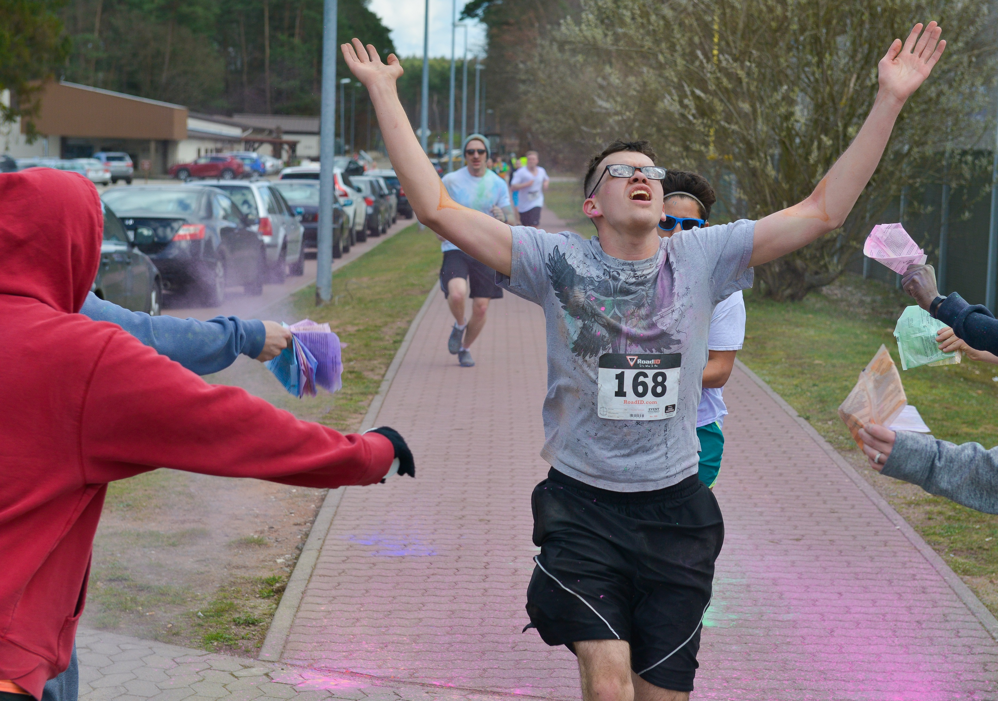 A runner sprints through the finish line during the 2016 Air Force  Assistance Fund Color Run bdb2c6177