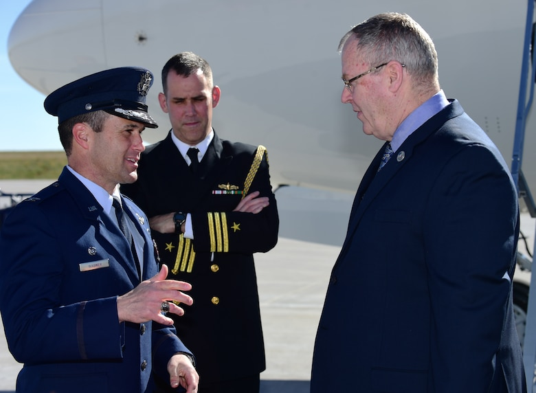 Deputy Secretary of Defense Bob Work speaks with Col. John  Wagner, 460th Space Wing commander, following his arrival April 12, 2016, at  Buckley Air Force Base, Colo. During his time on Buckley AFB, Work visited the  Aerospace Data Facility-Colorado. (U.S. Air Force photo by Staff Sgt. Darren  Scott/Released)