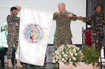 Vice Admiral Alexander Lopez of the Armed Forces of the Philippines, left, and Lieutenant General John Toolan of the United States Marine Corps unfurl the Exercise Balikatan 2016 flag during the opening ceremony.