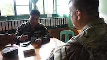 "Philippine Army, Lt. Col. Edgar Mangabay, Assistant Chief of Staff of Education and Training, Camp Capinpin, briefs Major Willam Flynn, acting Commander of the Hawaii National Guard CERF-P team, on the plan of the day during an office call for Balikatan 2016, April 07, 2016, Camp Capinpin, Philippines.  The Hawaii National Guard CERF-P team is supporting Balikatian 2016 through the National Guard State Partnership Program with the aim of building capability across the disaster response forces of both countries. Balikatan, which means ""shoulder to shoulder"" in Filipino, is an annual bilateral training exercise aimed at improving the ability of Philippine and U.S. military forces to work together during planning, contingency and humanitarian assistance and disaster relief operations."