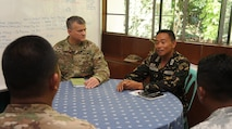 "Hawaii Army National Guard, Major Willam Flynn, acting Commander of the Hawaii National Guard CERF-P team and members of his full-time staff meet with Philippine Army, Col. Teofilo Commander Camp Capinpin, to discuss the plan for the United Search and Rescue exercise to be held during Balikatan 2016 April 07, 2016, Camp Capinpin, Philippines. (US Air Force Photo by Tech. Sgt. Andrew Jackson) The Hawaii National Guard CERF-P team is supporting Balikatian 2016 through the National Guard State Partnership Program with the aim of building capability across the disaster response forces of both countries. Balikatan, which means ""shoulder to shoulder"" in Filipino, is an annual bilateral training exercise aimed at improving the ability of Philippine and U.S. military forces to work together during planning, contingency and humanitarian assistance and disaster relief operations."