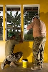Australian Army Sapper Scott Nolan, a carpenter from 21 Construction Squadron, 6th Engineer Support Regiment, right, and Lance Corporal Marco Rodriguez of the United States Marine Corps, paint a school building during Exercise Balikatan 2016.