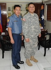 Officer Christian Celestino (left), a police officer with the Philippine National Police, and Spc. Roel Fantilanan, a U.S. Army Soldier in the 25th Infantry Division, and native of Koronadal City, Philippines, stand shoulder-to-shoulder, April 7, during a visit to Philippine National Police Camp, in Manila, Philippines. Fantilanan met with several classmate from his pervious unit and shared his experience in the U.S. Army.