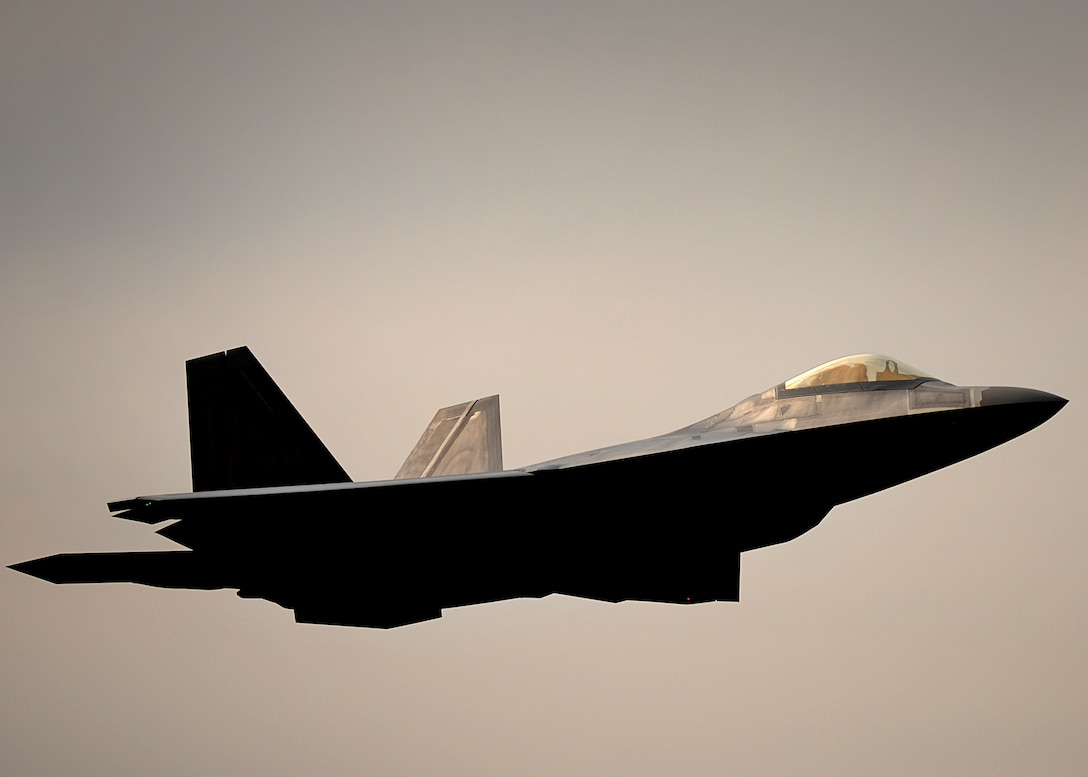 An F-22 Raptor from the 95th Fighter Squadron conducts air-to-air training April 11, 2016, at Royal Air Force Lakenheath, England. The training with F-15E Strike Eagles from the 494th Fighter Squadron, allowed the perfect opportunity for the advanced aircraft to train alongside other U.S. Air Force aircraft, joint partners and NATO allies. (U.S. Air Force photo/Tech. Sgt. Matthew Plew)