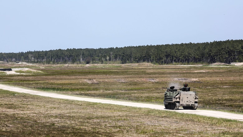 Marines with Alpha Company, 2nd Assault Amphibian Battalion fire on targets with their amphibious assault vehicle during a gunnery skills exercise at Marine Corps Base Camp Lejeune, N.C., April 13, 2016. Marines utilized the AAV's .50 caliber machine gun and Mk-19 40mm grenade launcher to engage targets at distances between 400 and 2000 meters.