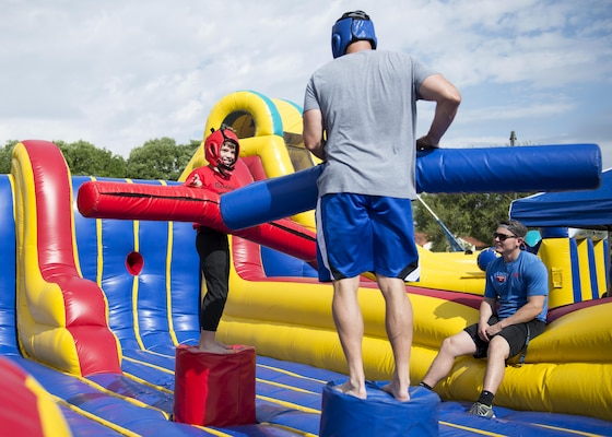 Members of Joint Base San Antonio-Randolph joust during Famaganza at the Youth Programs Complex on JBSA-Randolph April 9, 2016. Famaganza, a free family event open to all Department of Defense cardholders, featured entertainment, food and information booths.