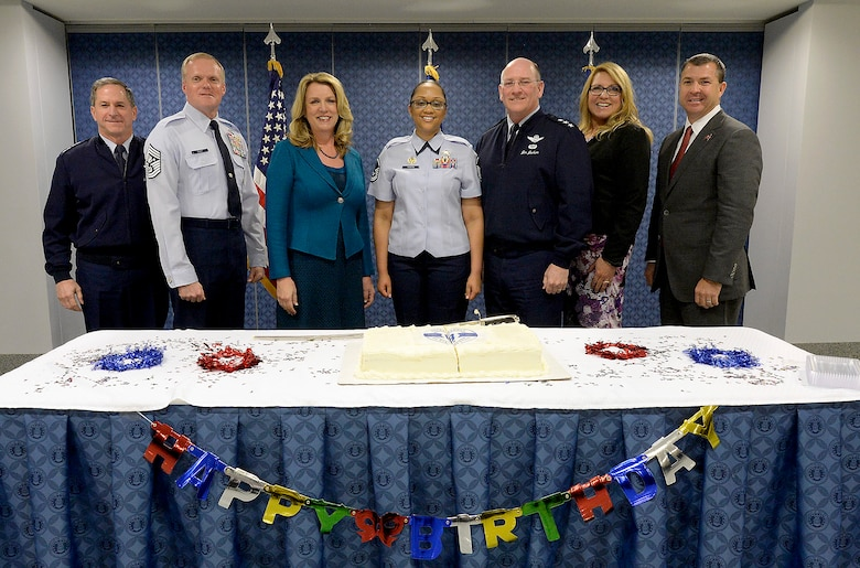 Celebrating the Air Force Reserve's 68th birthday during a Pentagon ceremony April 14, 2016, are, from left, Air Force Vice Chief of Staff Gen. David Goldfein; Chief Master Sgt. of the Air Force James A. Cody; Air Force Secretary Deborah Lee James; Master Sgt. Kandi Costa; Lt. Gen. James F. Jackson, the Air Force Reserve chief and commander of Air Force Reserve Command; radio personality Delilah; and Brian Ford. Delilah and Ford are civic leaders for Air Force Reserve Command. (U.S. Air Force photo/Scott M. Ash)