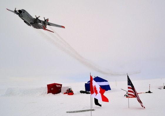 An LC-130 Hercules, assigned to the New York Air National Guard's 109th Airlift Wing, flies over an ice camp on Sherard Osborne Island, Nunavut, during Operation Nunalivut in 2014. The New York ANG flies the only ski-equipped C-130 aircraft in the world and is supporting this year's exercise. (Courtesy photo/Canadian Armed Forces)