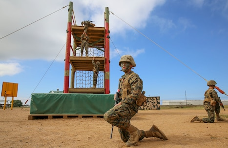 Private Joseph A. Pratt, Alpha Company, 1st Recruit Training Battalion, waits for his turn to climb an obstacle during the Crucible at Marine Corps Base Camp Pendleton, Calif., April 12. Following recruit training, Pratt will report to the School of Infantry at Marine Corps Base Camp Pendleton, Calif., and then to his military occupational specialty school to become a motor transportation operator. Annually, more than 17,000 males recruited from the Western Recruiting Region are trained at MCRD San Diego. Alpha Company is scheduled to graduate April 22.