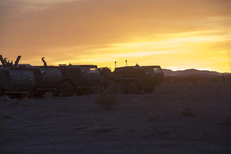 Logistics Vehicle System Replacements with Combat Logistics Battalion 7, prepare to move equipment at the Lead Mountain training area during 7th Marine Regiment's Combined Arms Live Fire Exercise aboard the Combat Center April 5, 2016. CALFEX served as the kinetic portion of Desert Scimitar 16, an annual 1st Marine Division training evolution. (Official Marine Corps photo by Cpl. Julio McGraw/ Released)