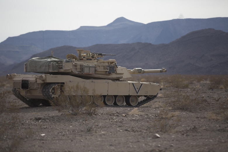 An M1A1 Abrams Main Battle Tank with Company B, 1st Tank Battalion, prepares to move toward its objective in the Blacktop training area during 7th Marine Regiment's Combined Arms Live Fire Exercise aboard the Combat Center April 6, 2016. CALFEX served as the kinetic portion of Desert Scimitar 16, an annual 1st Marine Division training evolution. (Official Marine Corps photo by Cpl. Julio McGraw/ Released)