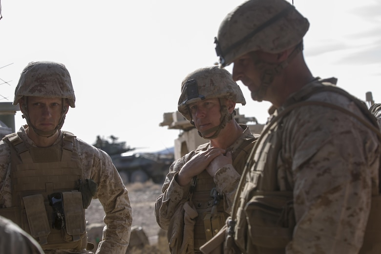 Lt. Col Andrew Nelson, commanding officer, 3rd Battalion, 7th Marine Regiment, Col. William Vivian, commanding officer, 7th Marine Regiment, and Maj. Gen. Daniel O'Donohue, Commanding General, 1st Marine Division, receive a brief on the maneuver of forces during the defense portion of 7th Marine Regiment's Combined Arms Live Fire Exercise aboard the Combat Center April 6, 2016. CALFEX served as the kinetic portion of Desert Scimitar 16, an annual 1st Marine Division training evolution. (Official Marine Corps photo by Cpl. Julio McGraw/ Released)