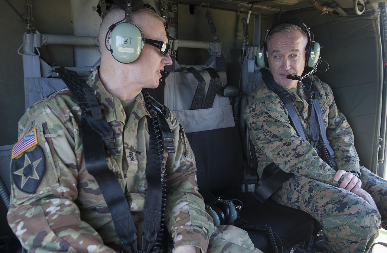 Army Command Sgt. Maj. John W. Troxell, senior enlisted advisor to the chairman of the Joint Chiefs of Staff, speaks to Marine Corps Gen. Joe Dunford, the chairman of the Joint Chiefs of Staff, aboard a UH-60 Black Hawk helicopter in Hawaii, Feb. 9, 2016. DoD photo by Navy Petty Officer 2nd Class Dominique A. Pineiro