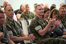 Col. Chris Pappas III, (left) and Maj. Gen. Gary L. Thomas congratulate volunteers during a volunteer appreciation award ceremony at Marine Corps Air Station Cherry Point, N.C., April 12, 2016. The award ceremony was held to recognize the more than 90,000 volunteer hours collectively accomplished by members of the air station community. Senior leaders represented their units along with DOD employees and service family volunteers as they received individual recognition for their volunteer efforts and the positive impact they have on the air station. Thomas is the 2d Marine Aircraft Wing commanding general and Pappas is the Cherry Point commanding officer. (U.S. Marine Corps photo by Cpl. N.W. Huertas/Released)