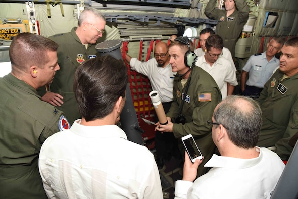 """Lt. Gen. William H. Etter (top left), Commander, Continental North American Aerospace Defense Region-1st Air Force (Air Forces Northern), listens to Chief Master Sgt. Rick Cumbo, 53rd Weather Reconnaissance Squadron weather reconnaissance loadmaster, explain to Mexican officials how a dropsonde collects weather data during hurricane flights. The general, along with Refael Pacchiano Alaman (bottom left), Secretary of Environment and Natural Resources, Mexico, and Roberto Ramirez de la Parra (bottom right), Director General of Con Agua, Mexico, (second from right), 53rd WRS """"Hurricane Hunters"""" and National Oceanic and Atmospheric Administration officials flew on a Hurricane Hunter WC-130J weather aircraft from Cabo San Lucas to Puerto Vallarta, Mexico, April 12, during the first part of the 2016 Caribbean Hurricane Awareness Tour, which promotes hurricane preparedness throughout the Central American and Caribbean regions."""