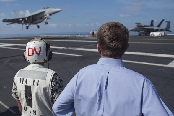 Defense Secretary Ash Carter and Philippine Defense Secretary Voltaire Gazmin watch as an aircraft conducts an arrested landing aboard the USS John C. Stennis in the South China Sea, April 15, 2016. DoD photo by Air Force Senior Master Sgt. Adrian Cadiz