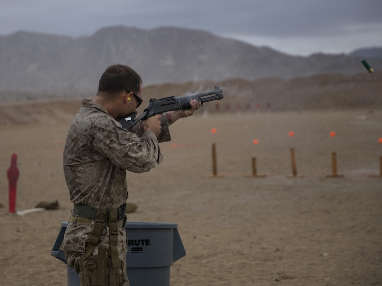 Cpl. James Tipton, Edson Range marksmanship coach, Marine Corps Recruit Depot San Diego, fires a Benelli M1014 shotgun at the Western Regional Combat Match April 8, 2016. Tipton and his team from MCRD San Diego took gold in the team competition. (Official Marine Corps photo by Cpl. Connor Hancock/Released)