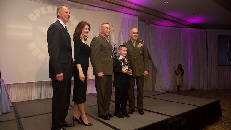 Christian Fagala receives the Military Child of the Year Award during the 2016 Military Child of the Year Award Ceremony April 14, at the Ritz-Carlton Hotel. According to the Operation Homefront website, the award recognizes military children who have demonstrated themselves as exceptional citizens while facing the challenges of military family life. Christian, 9, is the Marine Corps recipient of the award.