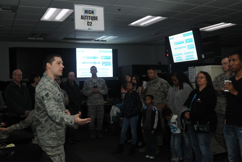 Senior Airman Christopher explains the importance if signals intelligence to Airmen and their families at an open house hosted by the 548th Intelligence, Surveillance and Reconnaissance Group at Beale Air Force Base on April 13, 2016. The 548th ISR Group opened their doors, allowing family members to get an inside look at the work their Airmen do on a daily basis. (U.S. Air Force photo by Airman 1st Class Jessica B. Nelson)