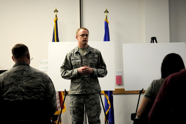 Col. Jacob J. Holmgren, the 548th Intelligence, Surveillance and Reconnaissance Group commander, briefs Airmen and their families about the day-to-day operations of the Distributed Ground Station-2 at an open house hosted by the 548th ISR Group at Beale Air Force Base, on April 13, 2016. The 548th ISR Group opened their doors, allowing family members to get an inside look at the work their Airmen do on a daily basis. (U.S. Air Force photo by Airman 1st Class Taylor A. Workman)