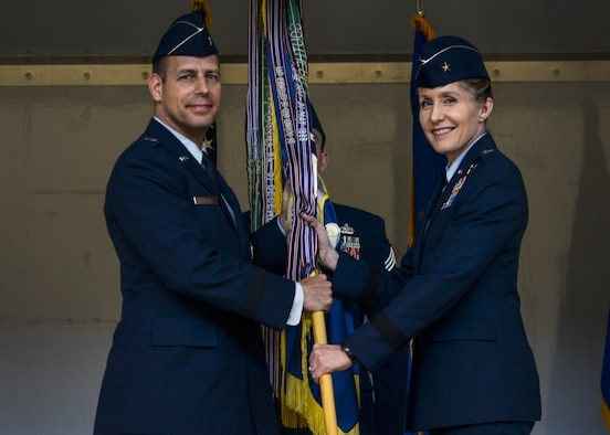 Brig. Gen. Jeannie M. Leavitt (right) assumes command of the 57th Wing from Brig. Gen. Paul A. Welch, U.S. Air Force Warfare Center vice commander, during a change of command ceremony at the Strike Aircraft Maintenance Unit hangar at Nellis Air Force Base, Nev., April 15. Leavitt is responsible for 34 squadrons at 13 installations constituting the Air Force's most diverse flying wing. (U.S. Air Force photo by Airman 1st Class Kevin Tanenbaum)