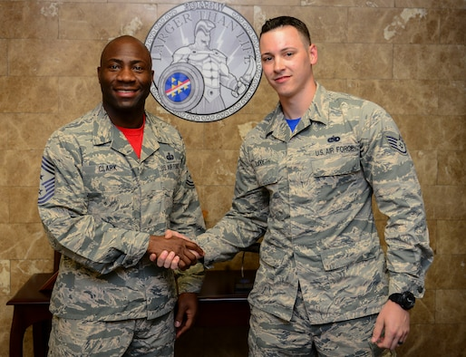 Chief Master Sgt. Vegas Clark, 39th Air Base Wing command chief, stands with Staff Sgt. Mark Suddeth, 39th Operations Support Squadron ground radar systems supervisor, in the 39th ABW front office before beginning Suddeth's chief shadow day April 15, 2016. Airmen are chosen for the command chief's shadow program based on their commander's recommendation about their dedication to the mission. (U.S. Air Force photo by Staff Sgt. Caleb Pierce/Released)