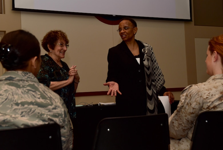 Julie Brand, Child Abuse Prevention, Education and Recovery Consultant, and Peggy Moore-McCoy, 460th Space Wing Sexual Assault Response Coordinator, speak to members of Team Buckley during a Sexual Assault Prevention and Response Program workshop April 14, 2016, at the Leadership Development Center on Buckley Air Force Base, Colo. Participants learned about proactive strategies for possible prevention and earlier intervention of child sexual abuse. (U.S. Air Force photo by Airman 1st Class Gabrielle Spradling/Released)