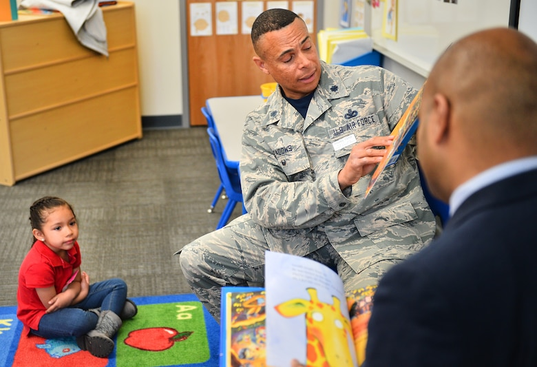 "Lt. Col. Herbert Meadows, 460th Mission Support Group deputy commander, reads to children at Edna and John W. Mosley P-8 school April 15, 2016, in Aurora, Colo. One Book 4 Colorado, a program designed to promote early literacy skills, chose the book ""Giraffes Can't Dance"" to pass out to 4-year-olds across Colorado. (U.S. Air Force photo by Staff Sgt. Darren Scott/Released)"