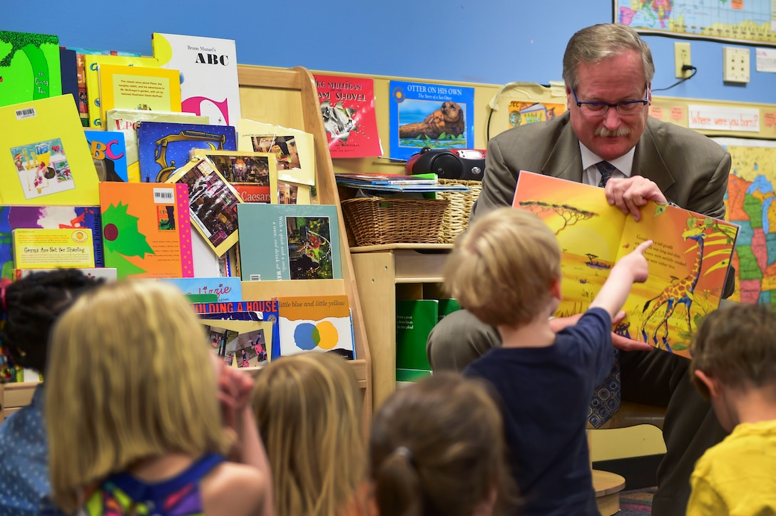 "Mickey Hunt, Colorado Department of Military and Veterans Affairs deputy executive Director, reads to children as part of the One Book 4 Colorado program April 14, 2016, at the A-Basin Child Development Center on Buckley Air Force Base, Colo. One Book 4 Colorado donates 75,000 copies of the ""Giraffes Can't Dance"" book to every school-age 4-year-old in the state. (U.S. Air Force photo by Staff Sgt. Katrina M. Brisbin/Released)"
