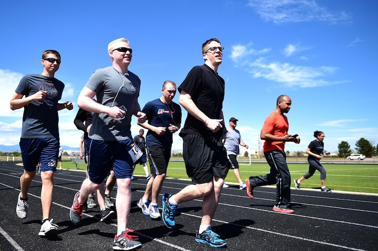 Team Buckley members participate in the Dash to Distance 5K April 14th, 2016, on Buckley Air Force Base, Colo. The Dash to Distance race series from April to September range from a 5K to a half marathon. (U.S. Air Force photo by Senior Airman Racheal E. Watson/Released)