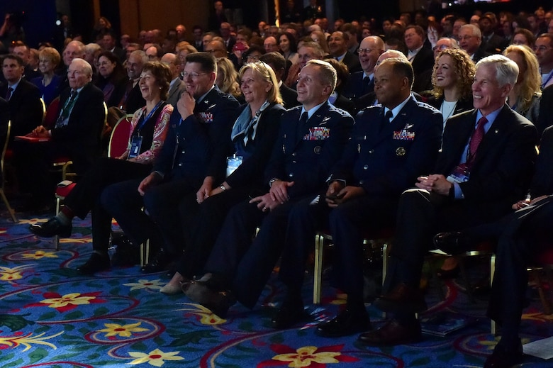 Audience members laugh during Gen. John Hyten's, commander of Air Force Space Command, speech April 12, 2016, at the Space Symposium at the Broadmoor Hotel in Colorado Springs, Colo. The symposium has brought together space leaders from around the world for more than 30 years to address the progression and future of space. (U.S. Air Force photo by Airman 1st Class Gabrielle Spradling/Released)