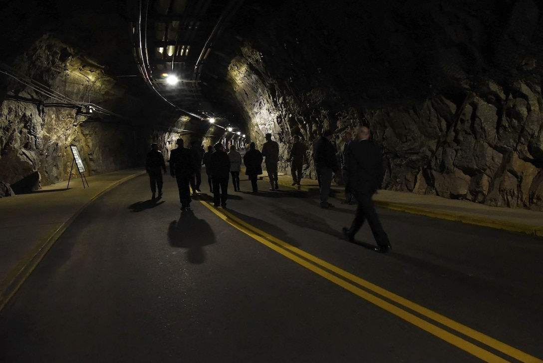 CHEYENNE MOUNTAIN AIR FORCE STATION, Colo. – 50th Anniversary Rededication Ceremony attendees  tour the north portal tunnel at Cheyenne Mountain Air Force Station April 15, 2016. Since its inception during the Cold War through the war on terrorism, Cheyenne Mountain has remained critical to the defense mission providing command and control for the nation since 1966. Cheyenne Mountain AFS is owned by the 21st Space Wing at Peterson Air Force Base, and operated by the 721st Mission Support Group. (U.S. Air Force photo by Airman 1st Class Dennis Hoffman)