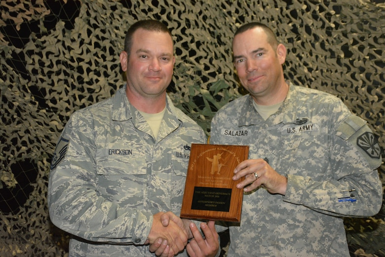 Master Sgt. Scott Erickson of the 161st Air Refueling Wing and Command Sgt. Maj. John Salazar of the Arizona Army National Guard's Recruiting and Retention Battalion, were recognized as the top marksmen during 2016's The Adjutant General's Match. Hosted by the Arizona Army National Guard's Small Arms Training Branch at the Florence Military Reservation, this four-day, eight event shooting competition featured 67 Guardsmen from the Arizona Army and Air National Guard. The top 12 shooters were awarded the Governor's dozen tab and have the opportunity to compete at the regional and national levels. (U.S. Army National Guard photo by Sgt. 1st Class Monette Wesolek)