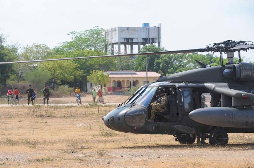 The crew of a UH-60 Blackhawk assigned to the 1st Battalion, 228th Aviation Regiment, Joint Task Force Bravo at Soto Cano Air Base, Honduras, prepare to conduct refueling operations at a forward-positioned staging base in Honduras, April 14, 2016. The forward area refueling point was set up to refuel Blackhawk aircraft being used in deck landing qualifications over the Caribbean Sea. (U.S. Air Force photo by Staff Sgt. Siuta B. Ika)