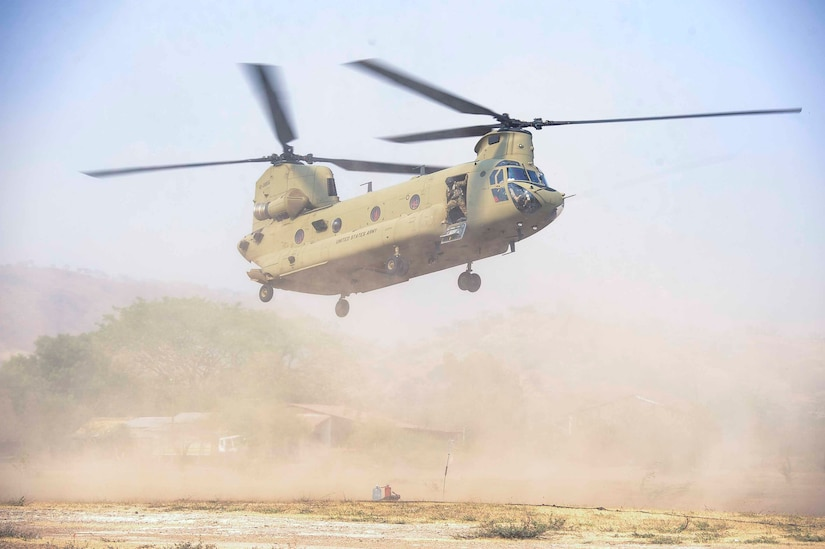 A CH-47 Chinook assigned to the 1st Battalion, 228th Aviation Regiment, Joint Task Force Bravo at Soto Cano Air Base, Honduras, prepares to land at a forward area refueling point in Honduras, April 14, 2016. The Chinook was carrying personnel and supplies to set up and sustain a FARP in an austere operating location in support of deck landing. (U.S. Air Force photo by Staff Sgt. Siuta B. Ika)