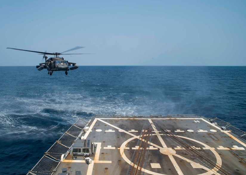 A UH-60 Blackhawk assigned to the 1st Battalion, 228th Aviation Regiment, Joint Task Force Bravo at Soto Cano Air Base, Honduras, prepares to land aboard the USS Lassen during deck landing qualifications off the coast of Honduras, April 14, 2016. The 1-228 enables partner-nation counter-trafficking missions and humanitarian assistance/disaster relief efforts throughout Central America. (U.S. Air Force photo by Staff Sgt. Siuta B. Ika)