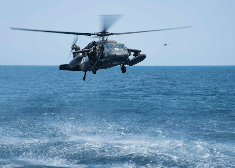 A UH-60 Blackhawk assigned to the 1st Battalion, 228th Aviation Regiment, Joint Task Force Bravo at Soto Cano Air Base, Honduras, approaches the USS Lassen during deck landing qualifications off the coast of Honduras, April 14, 2016. The 1-228 supports U.S. Southern Command's security cooperation strategy by providing heavy lift, medical evacuation and general aviation spanning the area of responsibility. (U.S. Air Force photo by Staff Sgt. Siuta B. Ika)