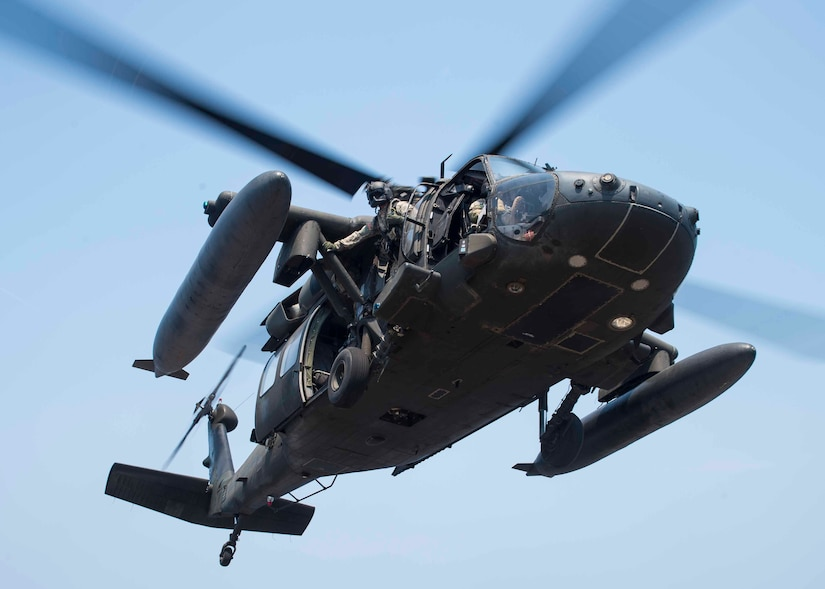 "A UH-60 Blackhawk assigned to the 1st Battalion, 228th Aviation Regiment, Joint Task Force Bravo at Soto Cano Air Base, Honduras, prepares to land on the USS Lassen during deck landing qualifications off the coast of Honduras, April 14, 2016. Thirty-three crew members completed ""bounces,"" which consisted landings, liftoffs, circling, then repeating. (U.S. Air Force photo by Staff Sgt. Siuta B. Ika)"